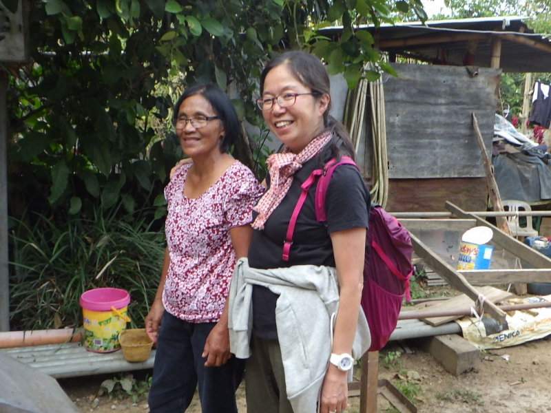 Antie Felly, an owner of Agroforestry Coffee farm in Tublay